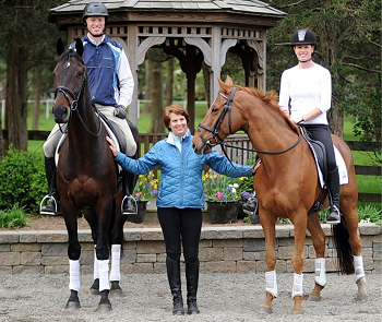 Adult riders on their horses with instructor